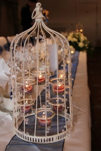 Beautiful Crystal T-Light Birdcages looked stunning placed either end of the Top Table.