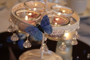Beautiful Crystal T-Light Centrepieces dressed with Midnight Blue butterflies.