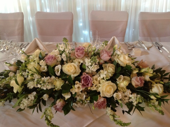 Beautiful Vintage Top Table Flowers created by Gill Pike Florist.
